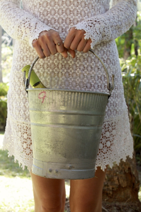 Girl with Wine Bucket Under Tree in White Delicate Lace Dress